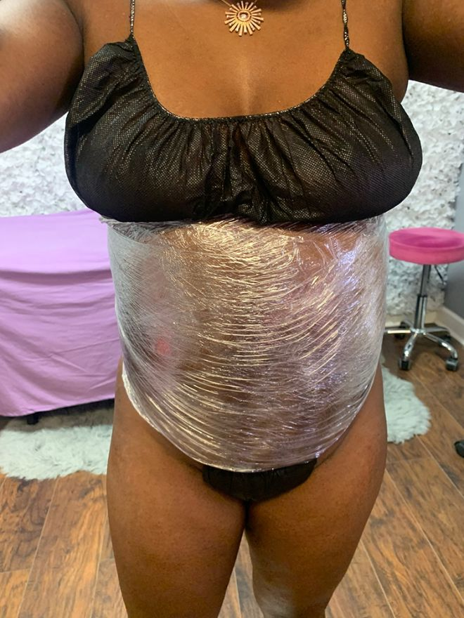 woman getting wrapped